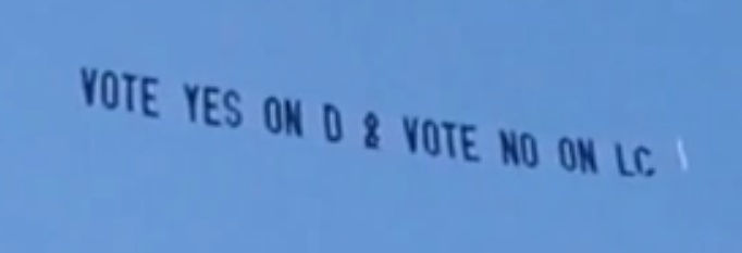 KSMO Banner tow to vote 'yes' on 'D' (screencap from SMAA YouTube upload)